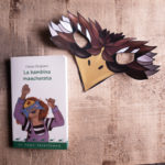 Maschera da Aquila, un libro, e una raccolta di maschere scaricabili